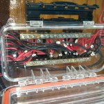 You can see the two bus bars and all the individual positive and negative leads connected. Also note the electrical labels that tell what panel each set of wires is conneted to. If you look closely you can see that both buss bars had di-electric grease applied to them as well as the ends of each wire being dipped in it and solidly covered before being connected to the buss bar. After everything is finished silicone will be applied around the wires where they penetrate individual holes drilled in the end of the junction box.